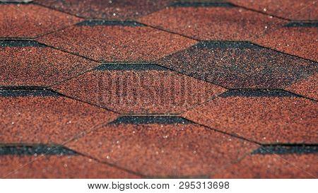 Asphalt Bitumen Shingles Photo. Close Up View On Asphalt Roofing Shingles Background. Roof Shingles