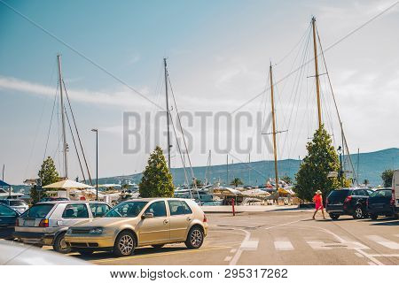 Parking For Cars And For Boats In Montenegro. Mountains On Background