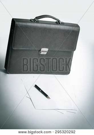 Brown Leather Briefcase Of A Businessman And A Handle In The Wor