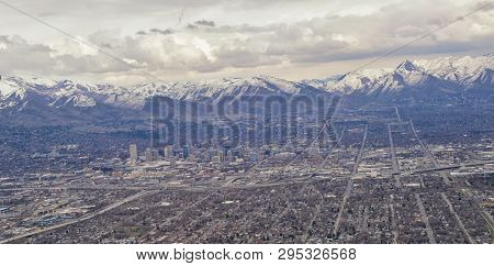 Downtown Salt Lake City Panoramic View Of Wasatch Front Rocky Mountains From Airplane In Early Sprin