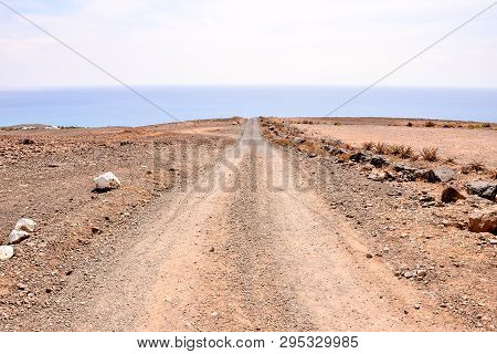 Photo Picture Of A Dirt Road Leading Off Into The Desert