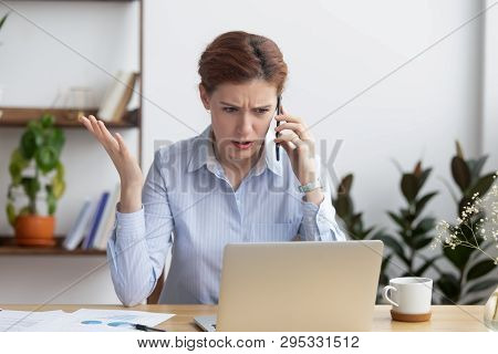 Angry Mad Businesswoman Talking On Phone Looking At Laptop