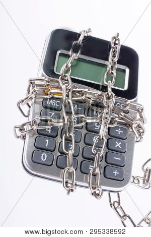 Calculator Wrapped In Chains On A White Background