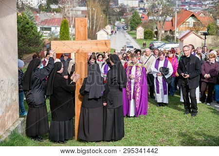 Ruzomberok, Slovakia - April 14: Nuns With Cross At Calvary. The Way Of The Cross During Easter On A