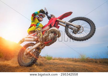 Motocross Rider Doing A Wheelie. Motorbike Sport Concept