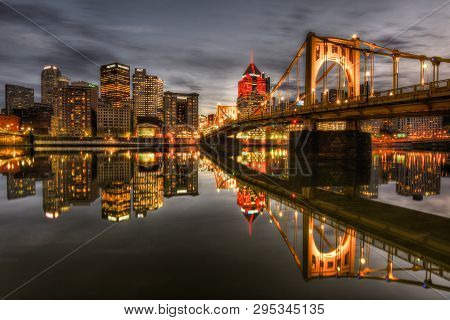 Pittsburgh, Pa - February 4, 2019: The Pittsburgh Skyline And Roberto Clemente Bridge At Night, Seen