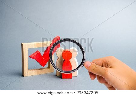 Magnifying Glass Is Looking At The People Stand Near The Checkbox For Voting In Elections. Lobbying