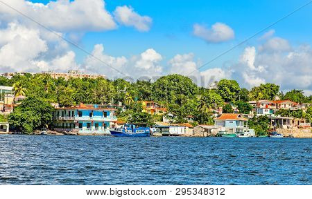 Jagua Cuban Village With Colorful Houses On The Hill And Fishing Boats,  Cienfuegos Province, Cuba