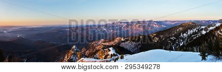 Winter Panorama From Cozia Peak On Olt River And Builla Vnaturarita Mountains