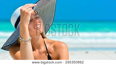 Fit Smiling Girl On A Tropical Beach With Hat. Sexy Woman With Hat On Paradise Tropical Beach. Beaut