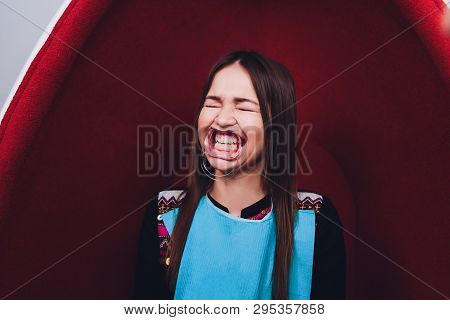 Close up of female mouth with retractor. Doctor flossing the teeth. Dental Gag. poster