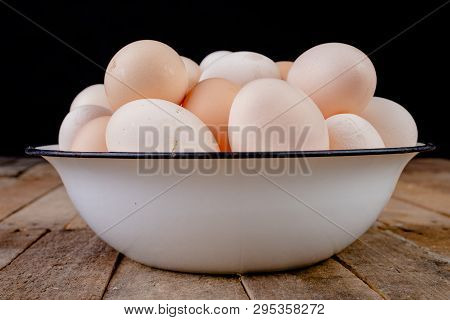 Fresh Hen Eggs In A Metal Enamel Bowl. Eggs Brought From A Hen House On A Wooden Table.