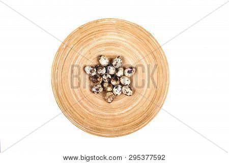 Isolated Quail Eggs In Wooden Plate Composition On Beige Background. Easter Concept.