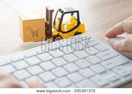 Mini Forklift Truck Load Cardboard Box With Text Online Shopping And Hand Using Mouse And White Keyb