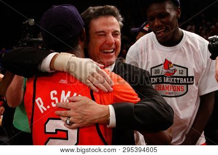 NEW YORK-MAR 10: Louisville Cardinals guard Russ Smith (2) hugs head coach Rick Pitino after winning the Big East Tournament against the Cincinnati Bearcats on March 10, 2012 in New York.