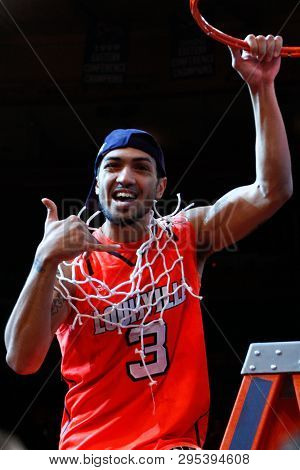 NEW YORK-MAR 10: Louisville Cardinals guard Peyton Siva (3) cuts the net after winning the Big East championship against the Cincinnati Bearcats on March 10, 2012 at Madison Square Garden in New York.
