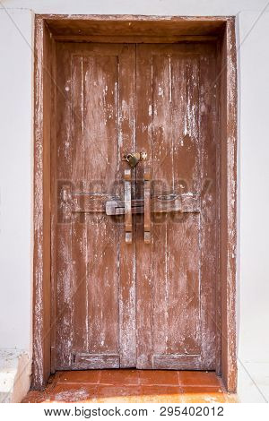 Old Wood Door On The White Wall