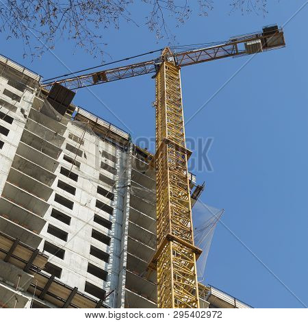 Crane Works In Building Construction Against Blue Sky. Construction Working. Square Image