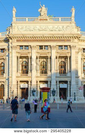 Vienna, Austria - September 17, 2018: Unknown People Walk Down Street Near Building Of Burgtheater (