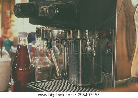 Small Professional Coffee Machine After Use In The Resturant. Vintage Retro Style Picture Added.