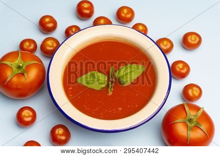 Gazpacho Cold Summer Vegetarian Tomato Soup With Basil In A Bowl On Bright Blue Minimal Background.