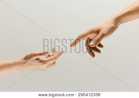 Moment Of Weightless. Two Male Hands Trying To Touch Like A Creation Of Adam Sign Isolated On Grey S