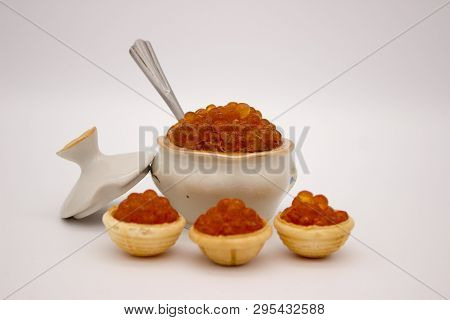 Luxury Red Caviar In The Bowl. Food Photo Concept.