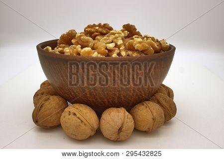 Walnut Kernels In Clay Bowl (other Names: Juglans Regia, Persian Walnut, English Walnut, Circassian