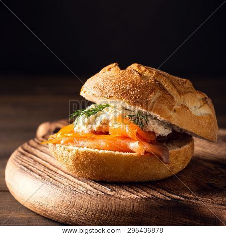 Sandwiche With Salmon And Herb Butter On Old Wooden Table. Healthy Food Background Concept With Copy