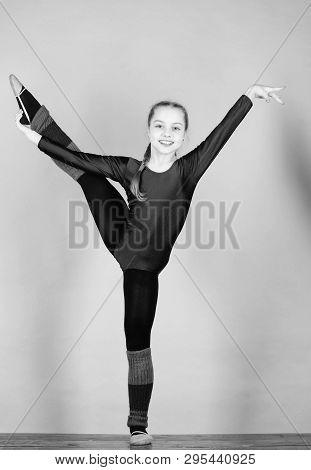 Girl little gymnast sports leotard. Physical education and gymnastics. Future star of rhythmic gymnastics. Rhythmic gymnastics sport combines elements ballet dance. Flexible healthy body. Try hard poster