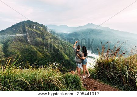 A Couple In Love Takes A Selfie. Man And Woman Holding Hands. The Couple Travels Around Asia. Travel
