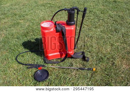 Red Herbicide Sprayer, On The Grass Is An Open Sprayer For Spraying Herbicides