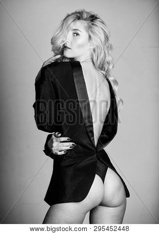 Tempting horny woman with jacket wearing on naked body. Lady boss sex game. Feeling so sexy. Booty sexy fashion lady. Girl sexy blonde wear formal jacket backwards. Woman sexy buttocks playful mood poster