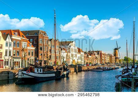 Old Historic District Delfshaven With Wildmill And Houseboats In Rotterdam, South Holland, The Nethe