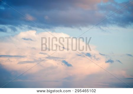 Blue sky background with white dramatic colorful clouds and sunlight, vast sky background. Natural sky background, sky sunny landscape. Sunny sky background, blue sky with white clouds