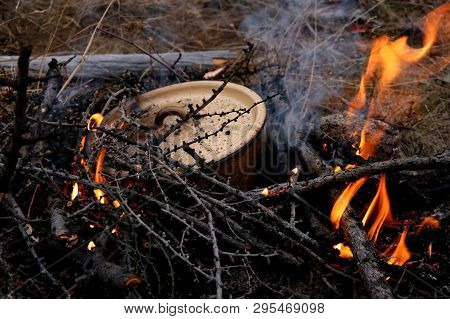 Cooking Eating Closed Metal Pan On Fire. Dinner On A Halt. Halt Of The Fisherman And Hunter
