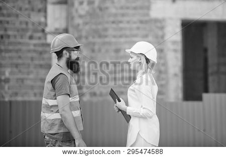 Discuss Progress Plan. Construction Industry Concept. Woman Engineer And Bearded Brutal Builder Disc