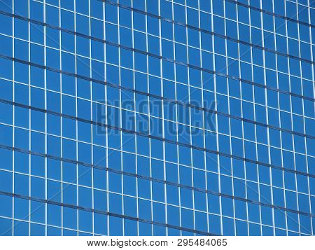 Background Of Blue Glass Windows That Reflect Sunlight.