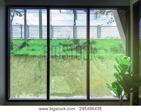 Mirror Window With Industry Factory Background, Green View Beside Window In Office, Flare Light Thro