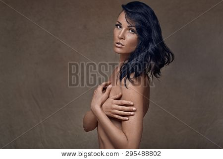 Beautiful Sexy Naked Middle-aged Woman Turning To Look Back At The Camera Over One Shoulder With A S