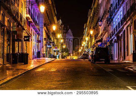 Lisbon, Portugal - 2019. Urban Night Scene. Old European City Illuminated Street At Night.