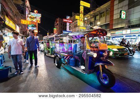 Bangkok, Thailand - March 2019: Tuk-tuk Taxi Driver At China Town Night Market.
