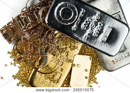 A Pile Of Gold And Silver Bars, Gold Jewelry And Gold Granules. Isolated On White Background.
