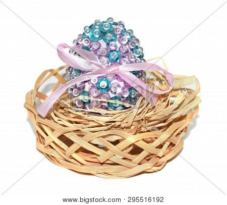 Stock Image Decorative Glitter Egg In The Basket Isolated On White Background