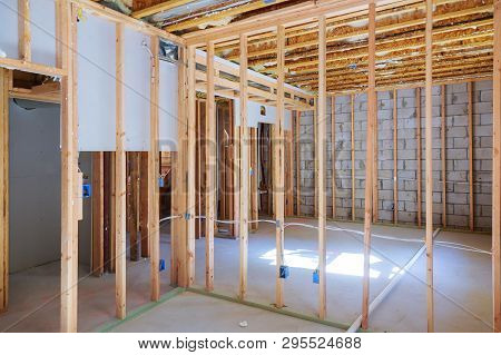New Under Construction Home Framing Unfinished Wood Frame Building Of A Basement Residential