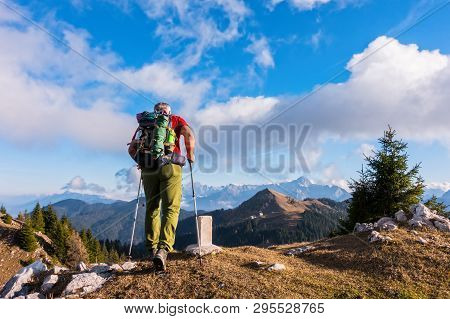 Hiker Walk On The Top Of Mountains
