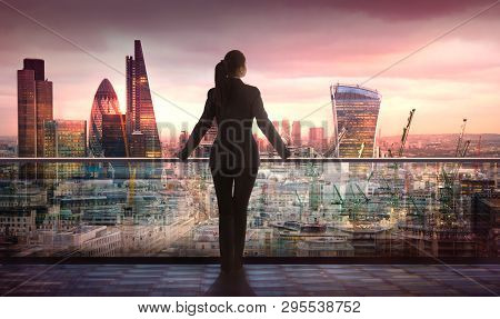 Young Woman Looking Over The City Of London Business And Banking Aria With Skyscrapers At Sunset. Fu