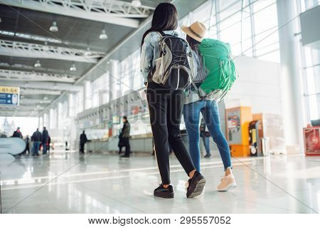 Female tourists in waiting area of airport