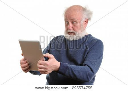Funny shocked senior man using tablet computer, isolated on white