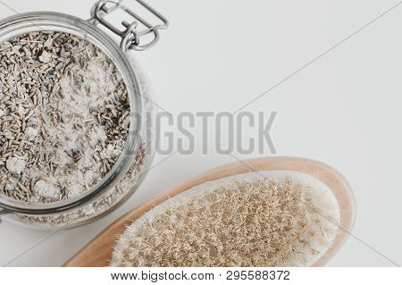 Lavender Body Scrub And Wooden Brush For Self Massage. Body Care And Spa Treatment. Exfoliating And